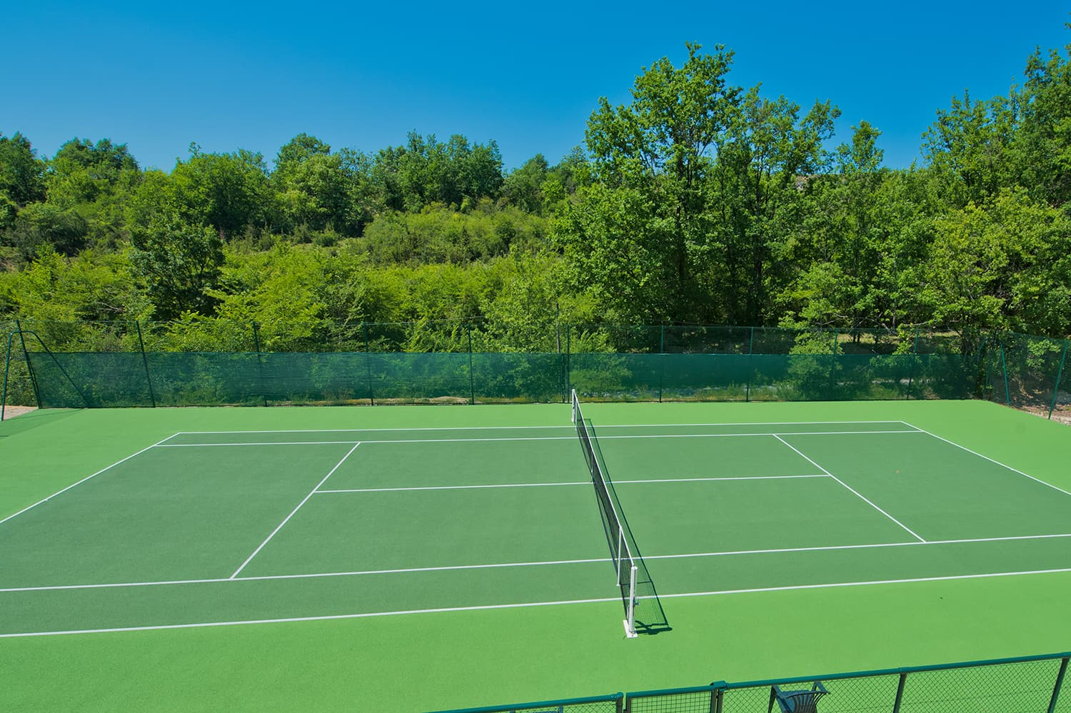 Holiday home in France with private tennis court