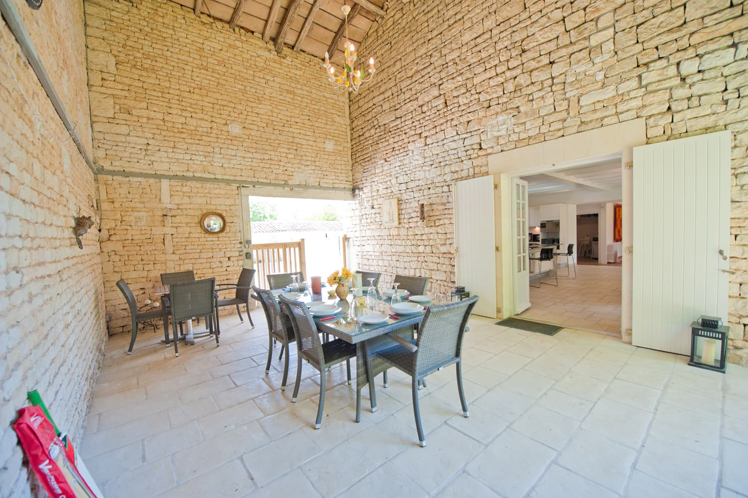 Covered dining terrace in West France rental accommodation