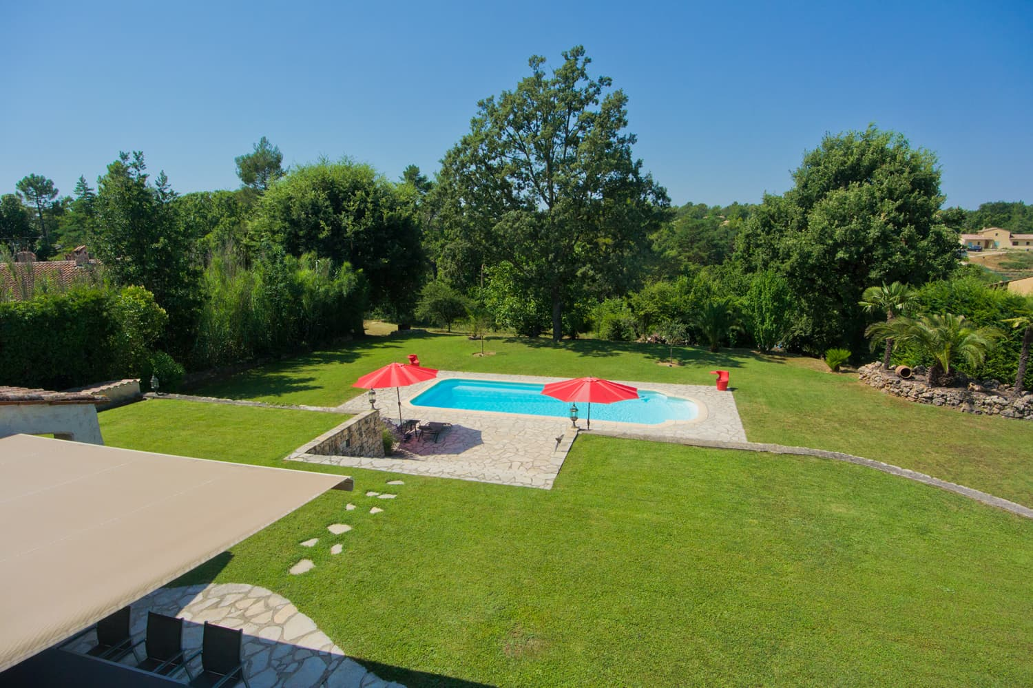 Lawned garden with private pool and terrace
