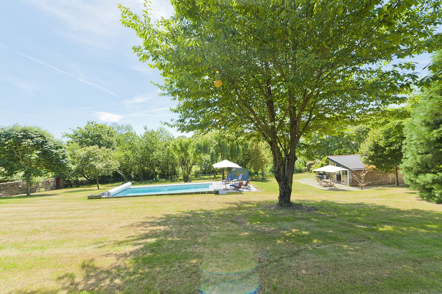 Loire rental house garden with private, heated pool