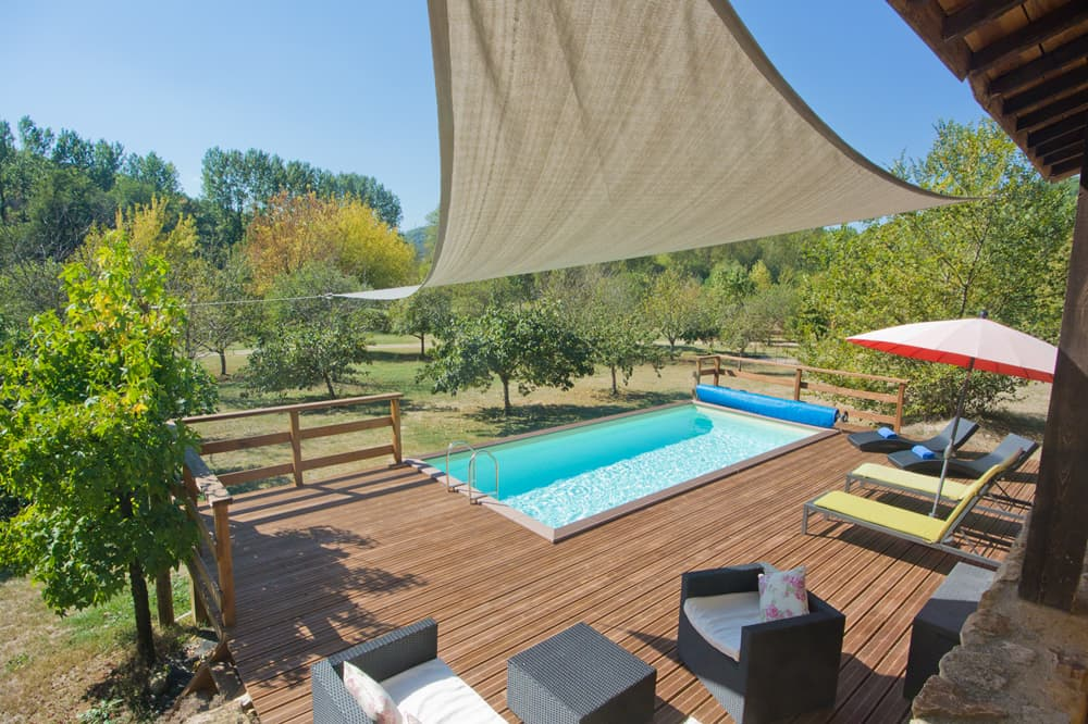 Private pool with wooden terrace decking