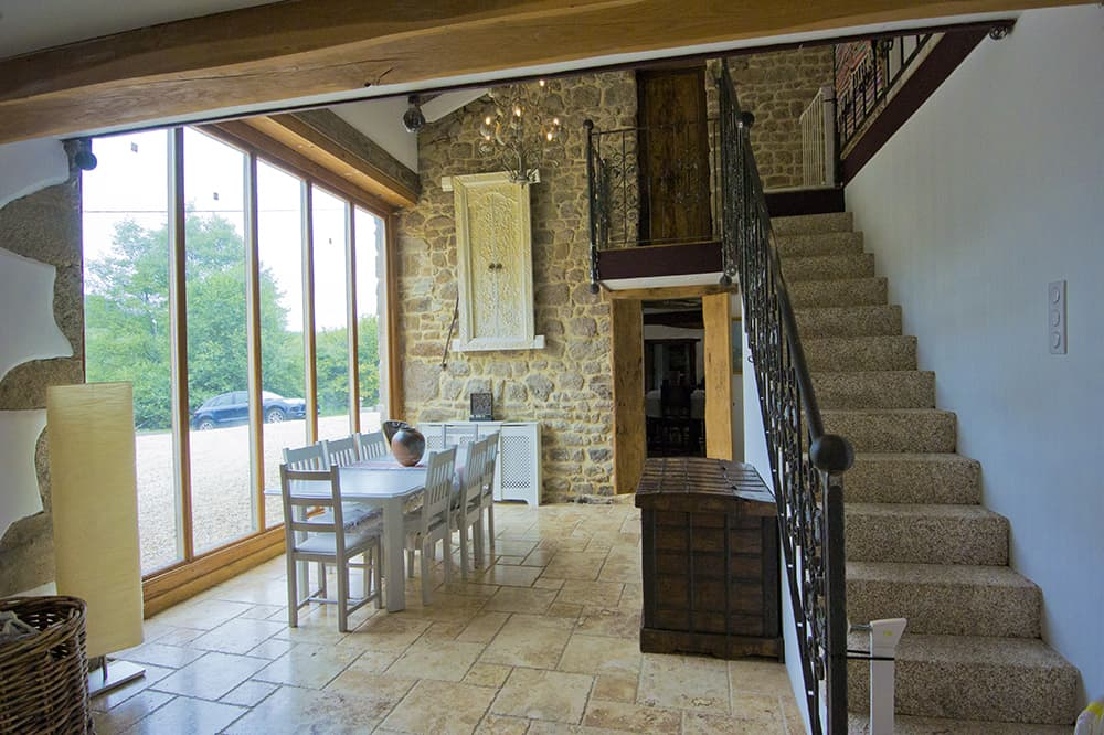 Dining room and staircase in Nouvelle-Aquitaine holiday home