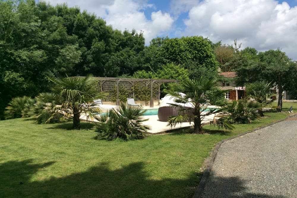Private heated pool with lawned garden