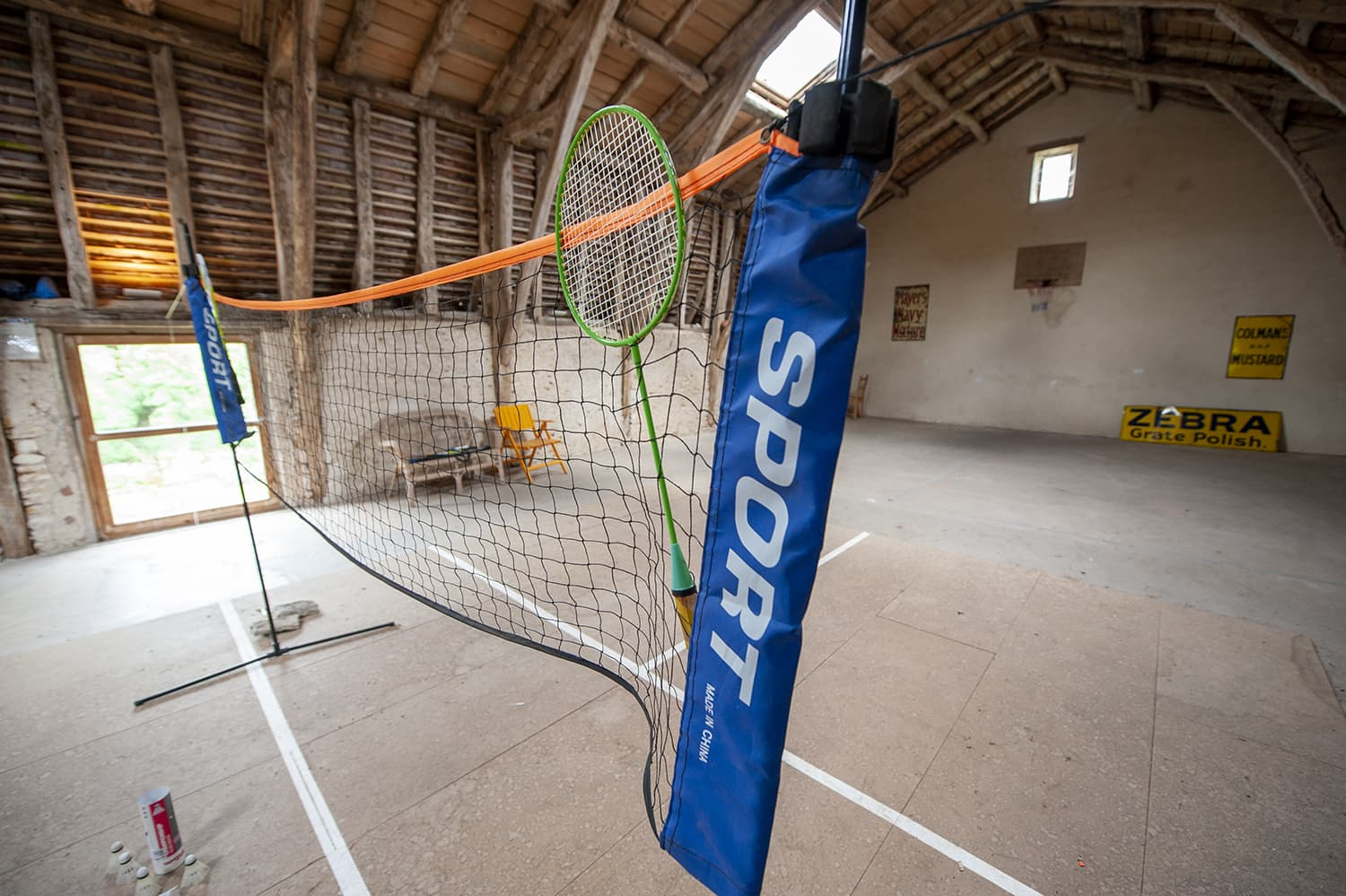 Badminton net in barn