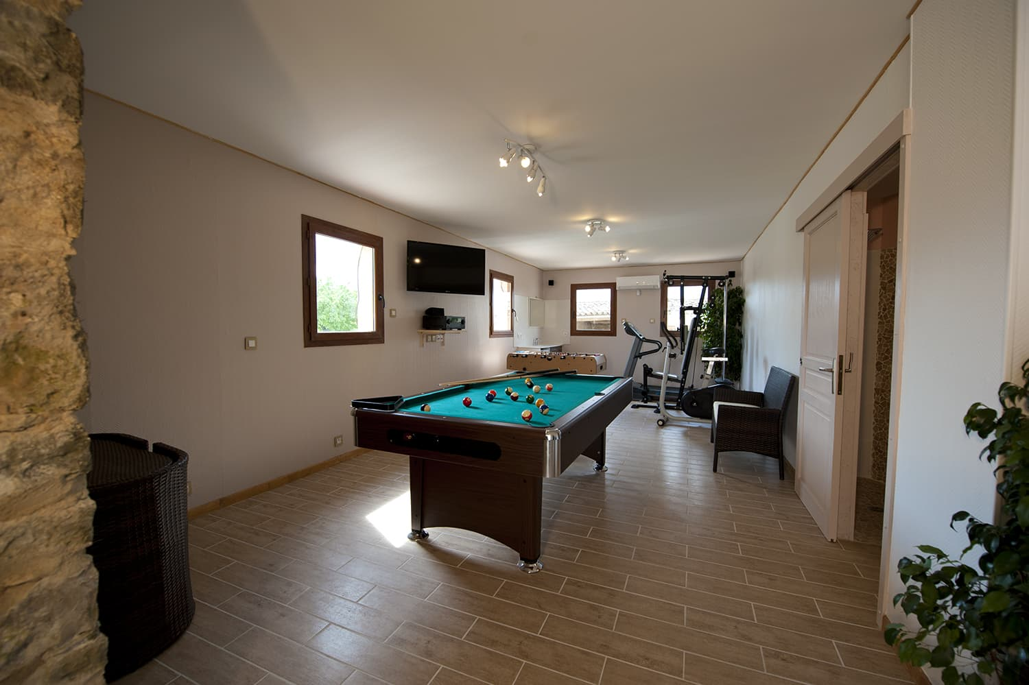 Games room with jacuzzi, sauna, exercise bike, treadmill and weights machine