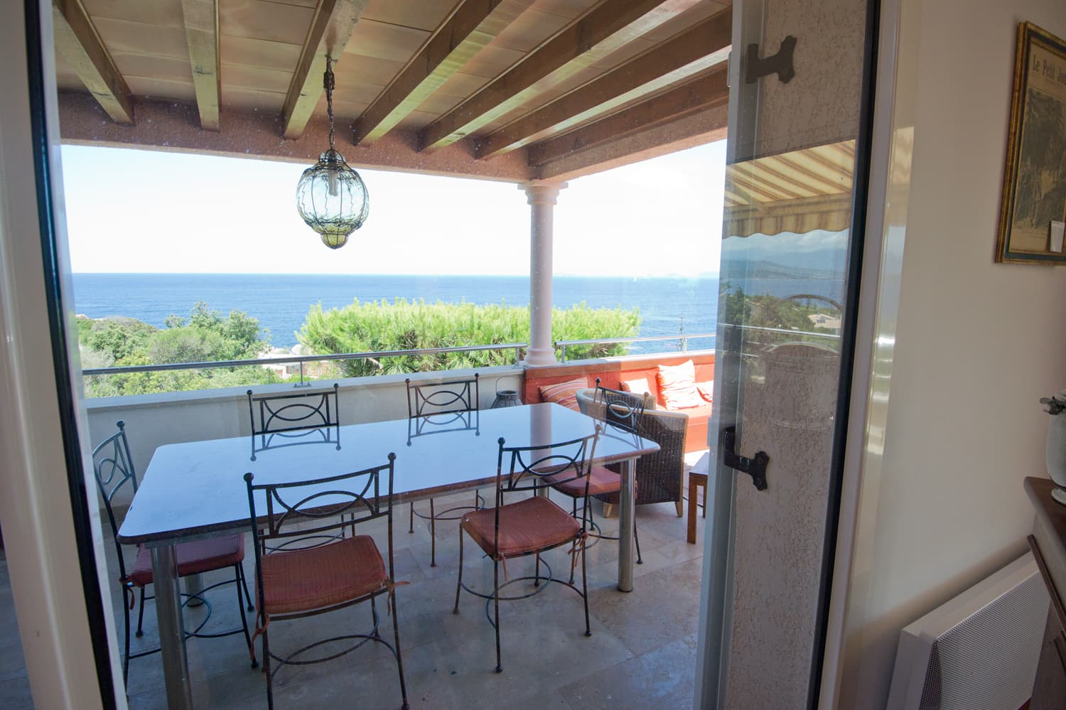 Covered dining terrace in Corsica holiday villa
