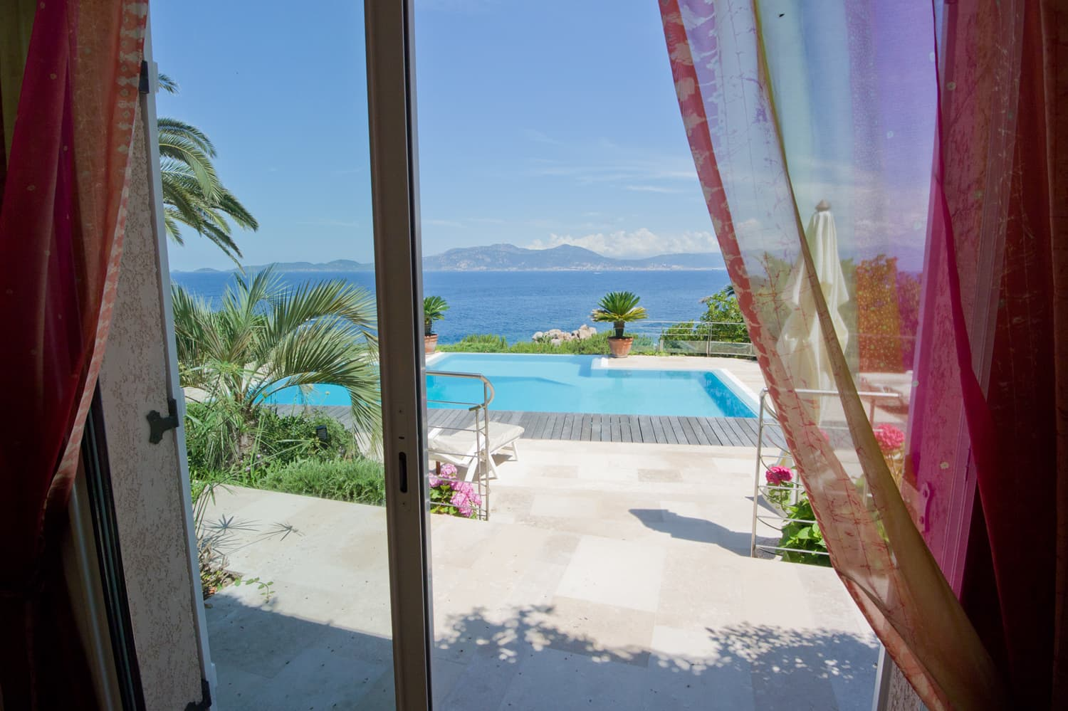 View of pool and Mediterranean Sea in Corsica holiday villa