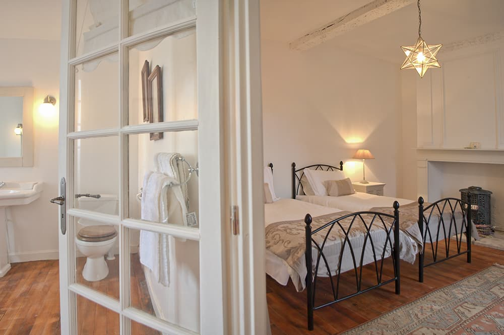 Bedroom with ensuite bathroom in South West France holiday accommodation