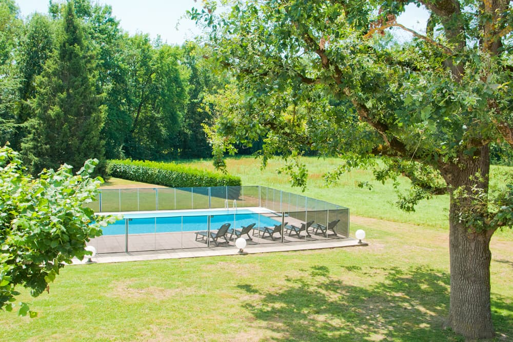 Lawned garden with private, heated pool