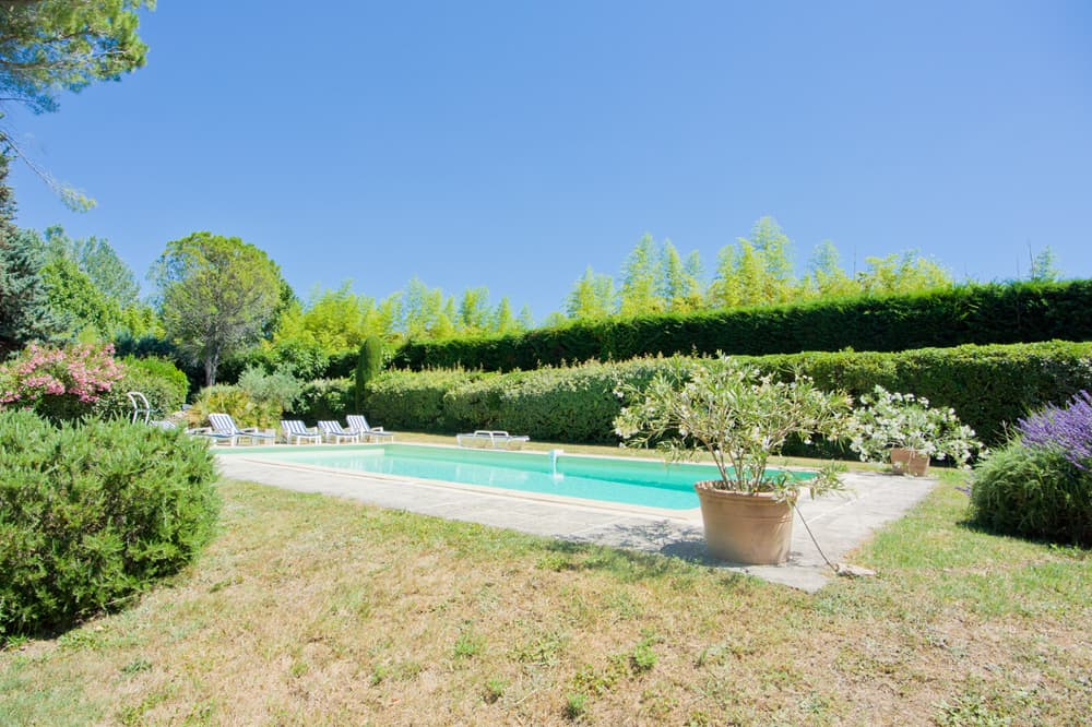 Private, heated pool with lawned garden