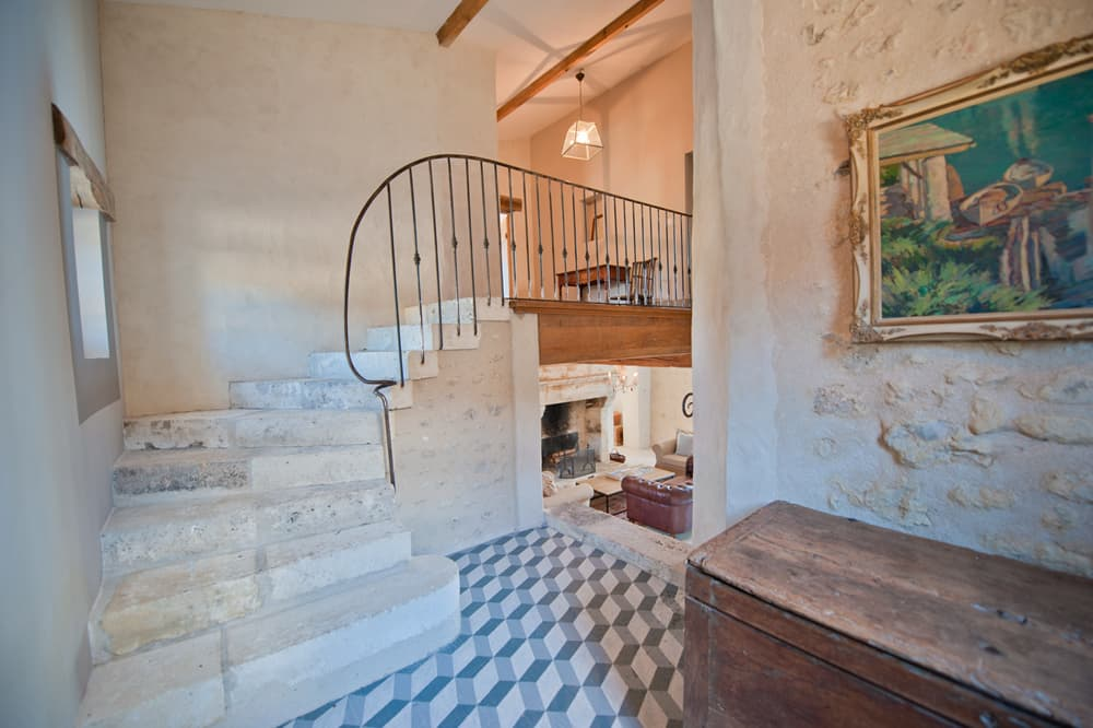 Hallway with staircase in Dordogne holiday home
