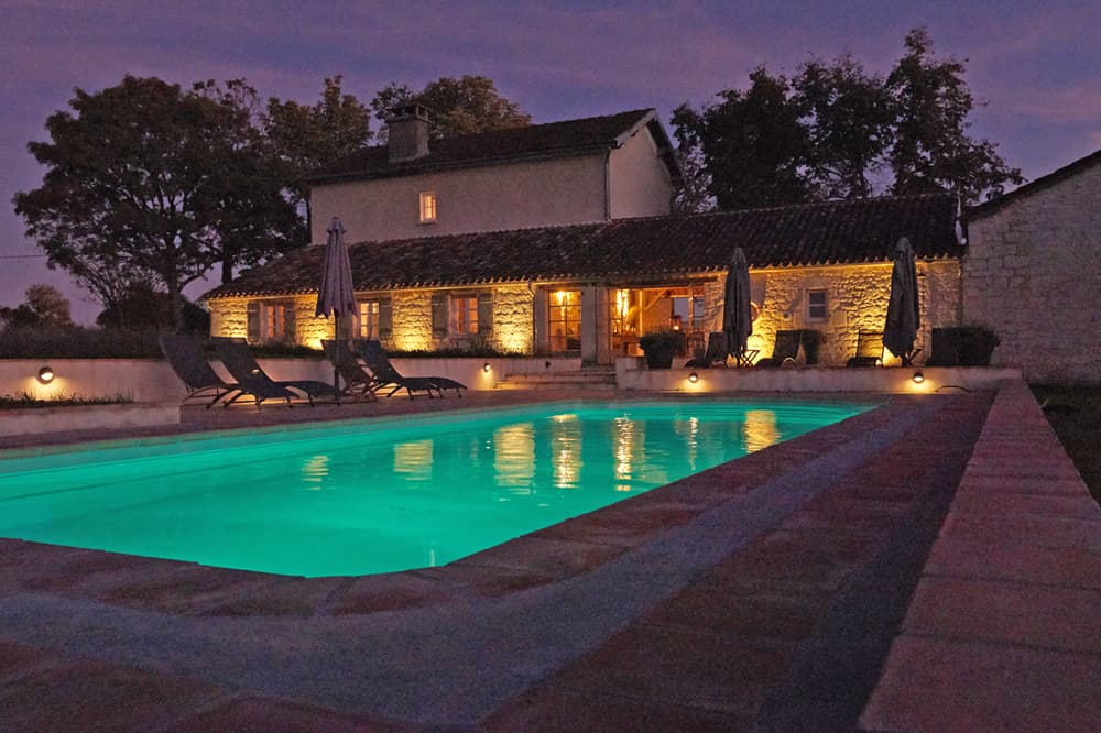 Holiday home in South West France with private pool at night