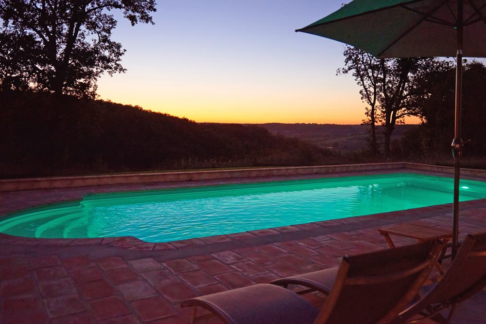 Private pool with terrace at night