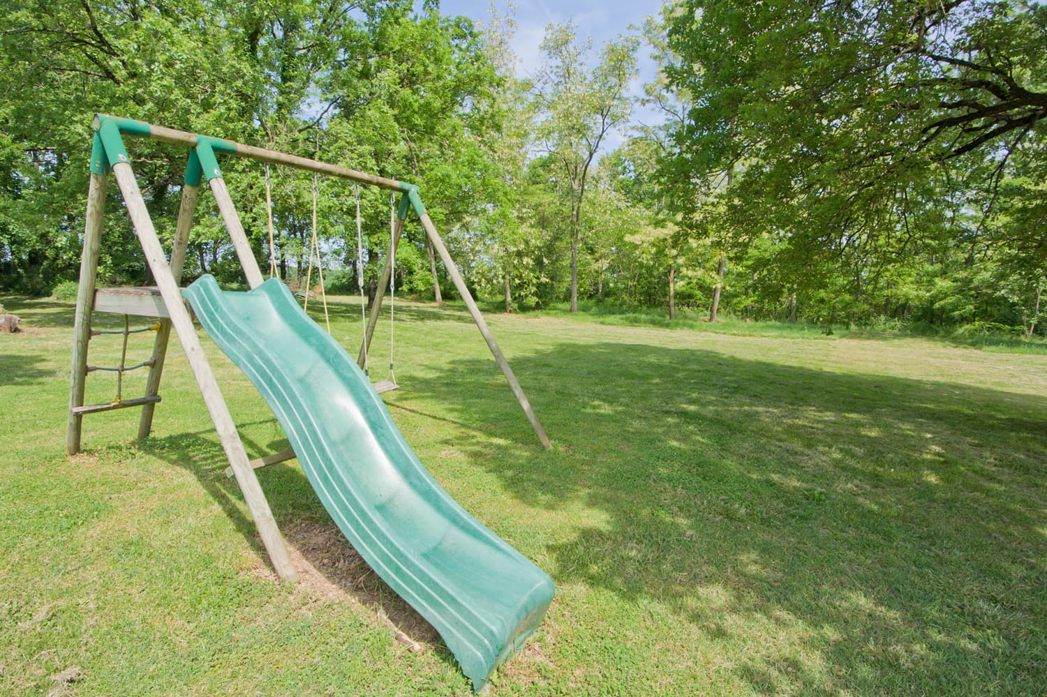 Lawned garden with slide and swings