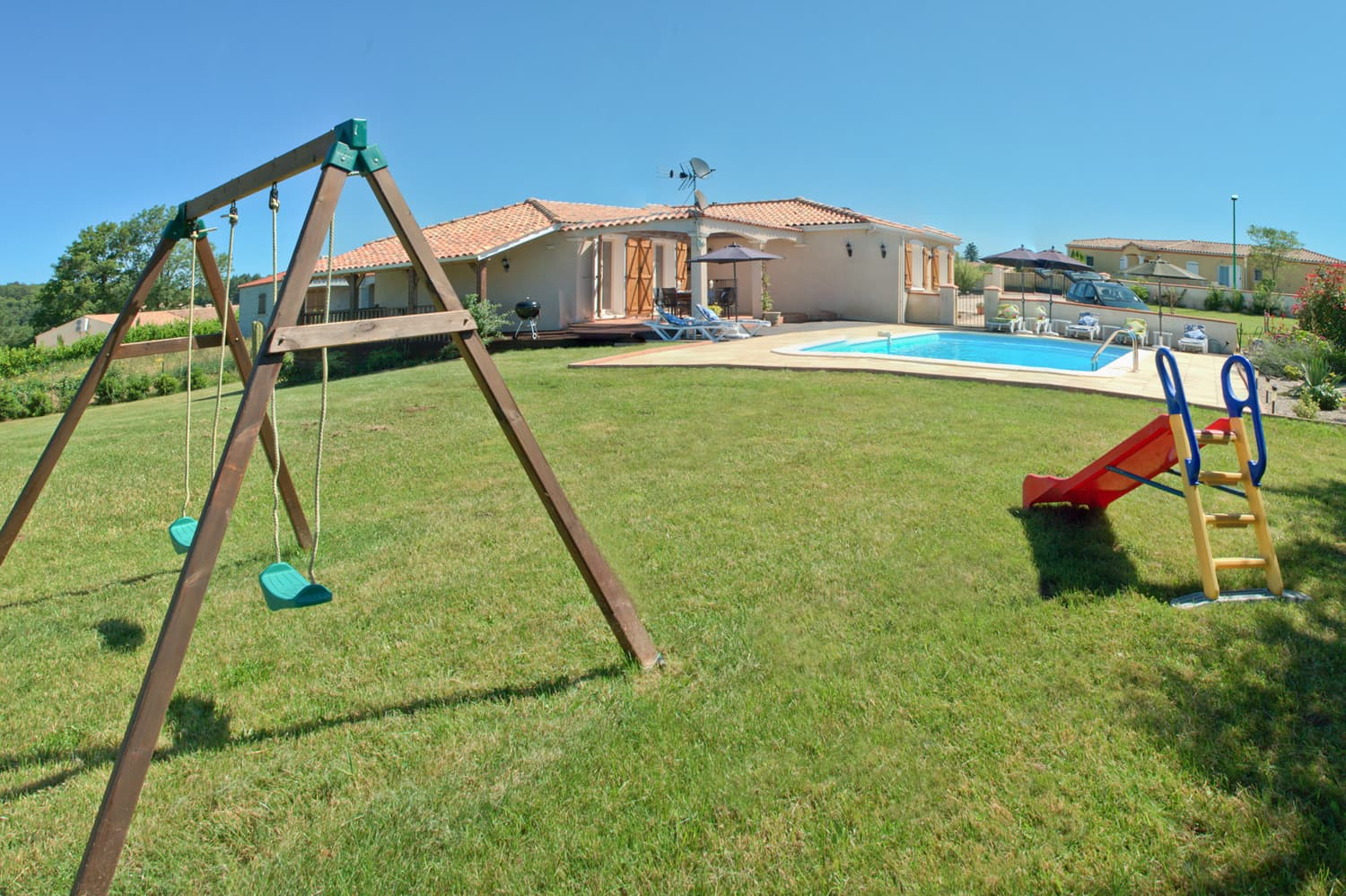 Garden with slide and swings