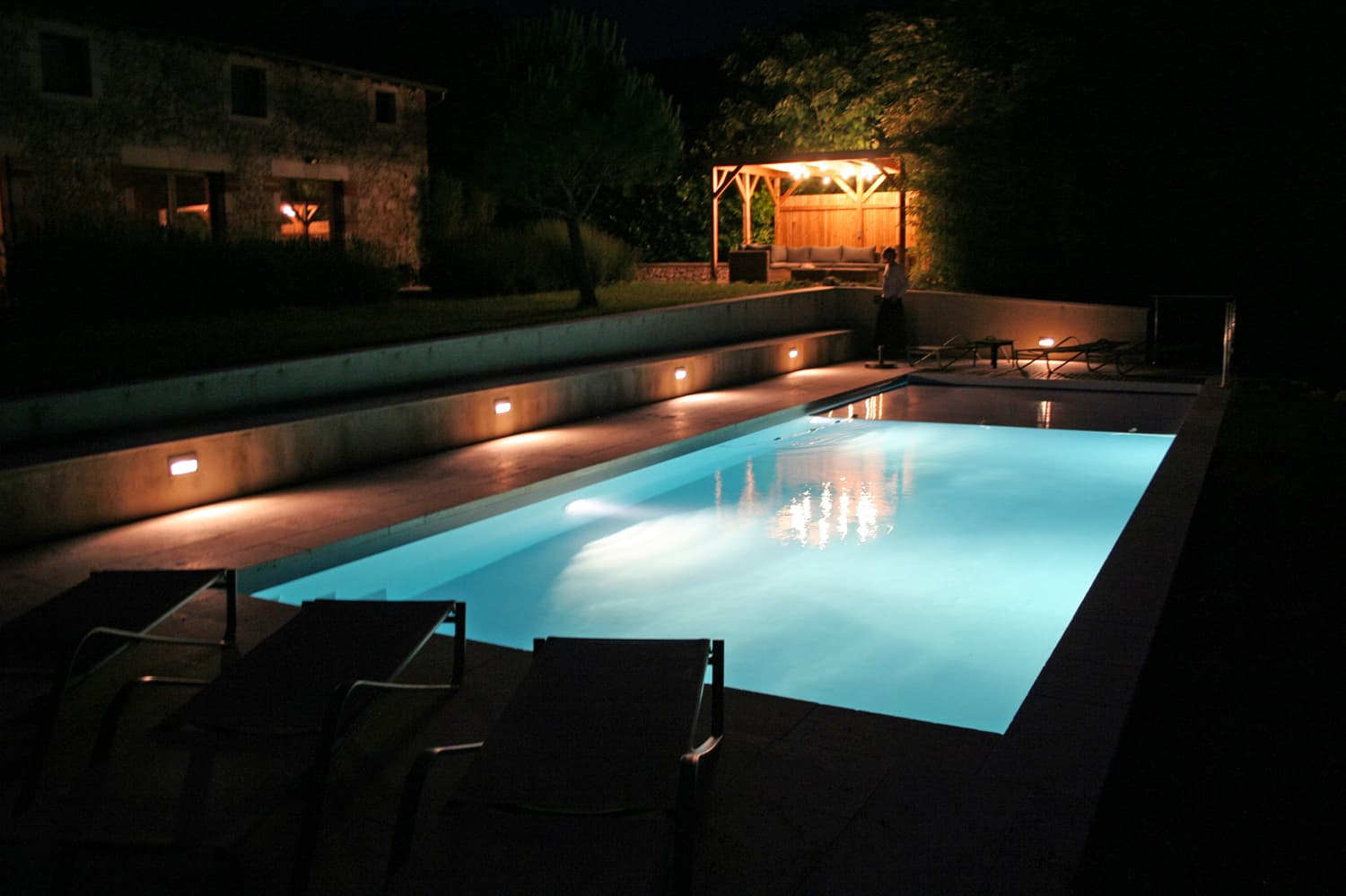 Private, heated pool at night