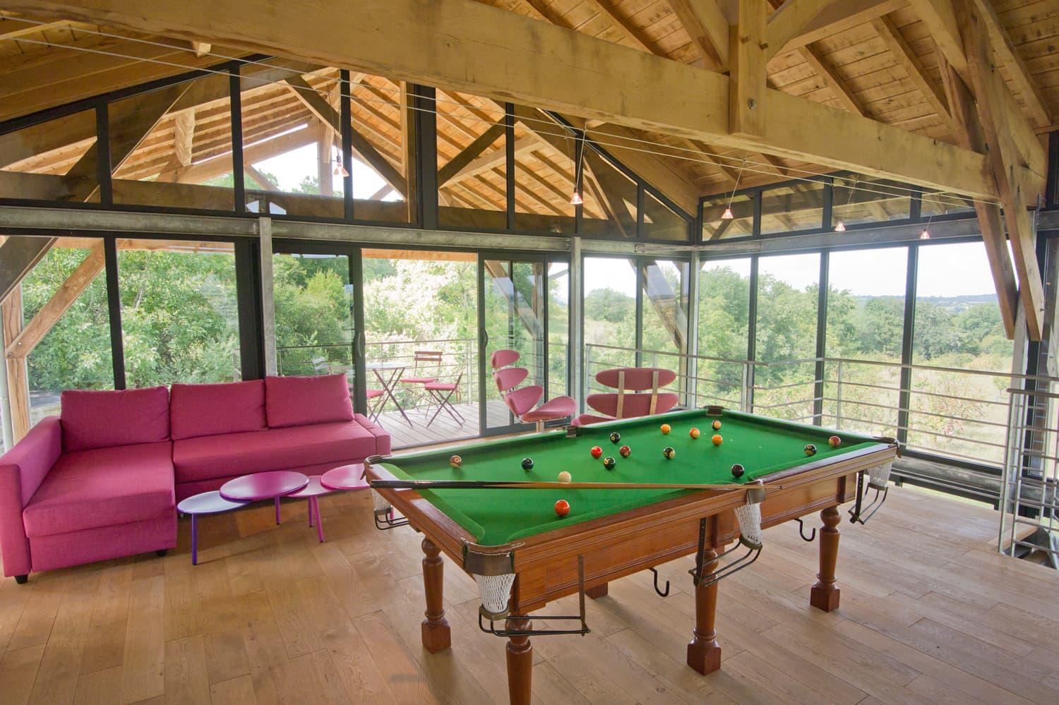 Living room with pool table in South West France holiday home