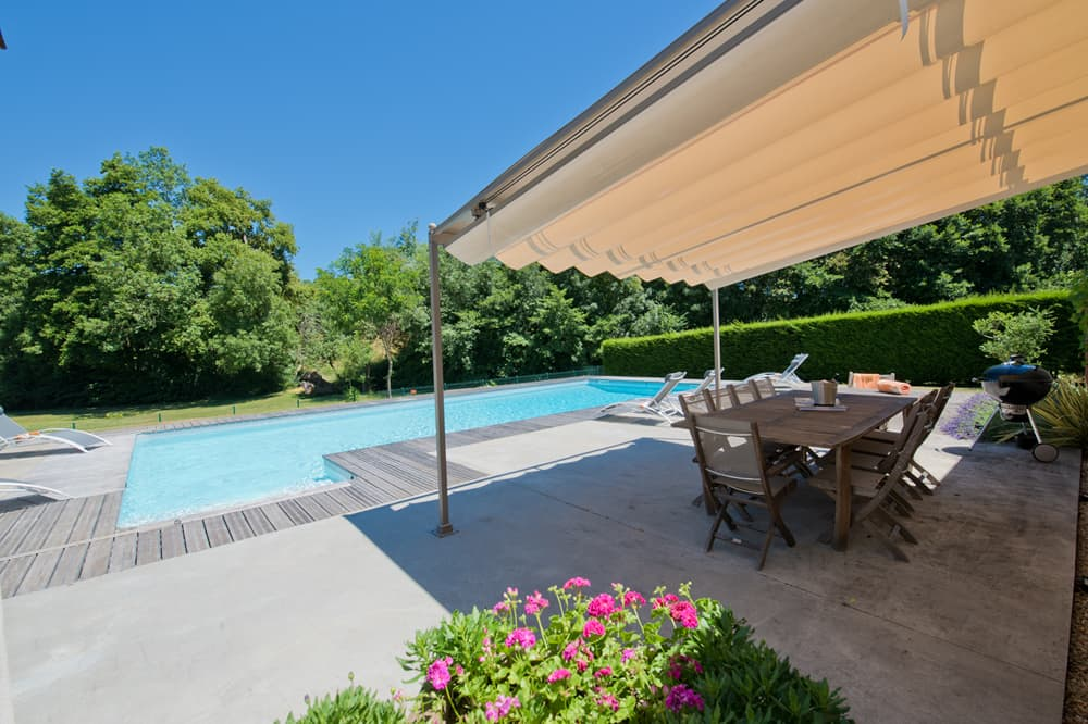 Private, heated pool with shaded terrace