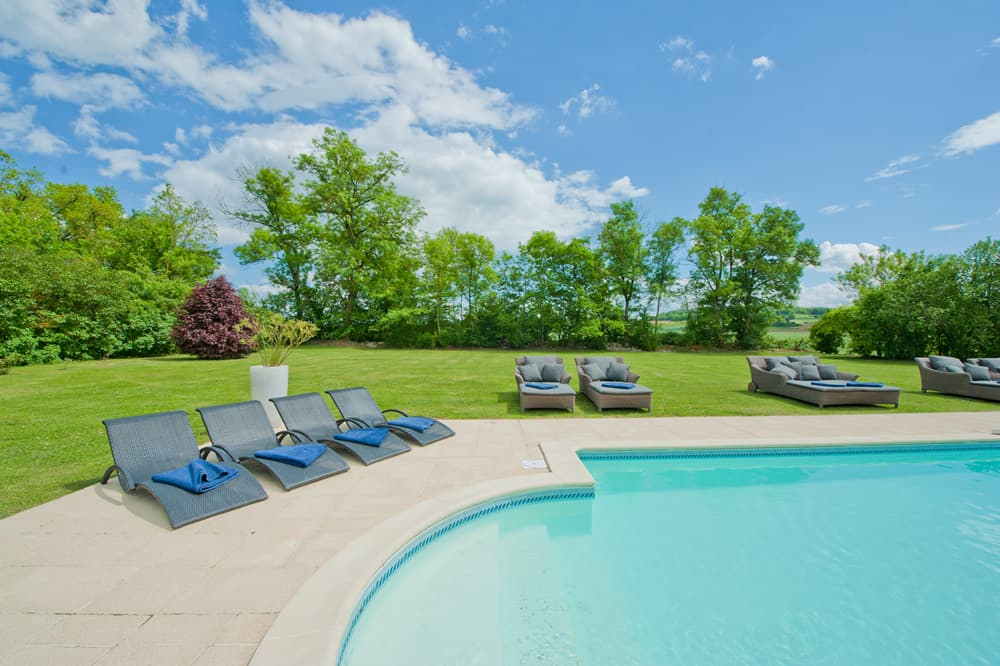 Private, heated pool with terrace and lawned garden