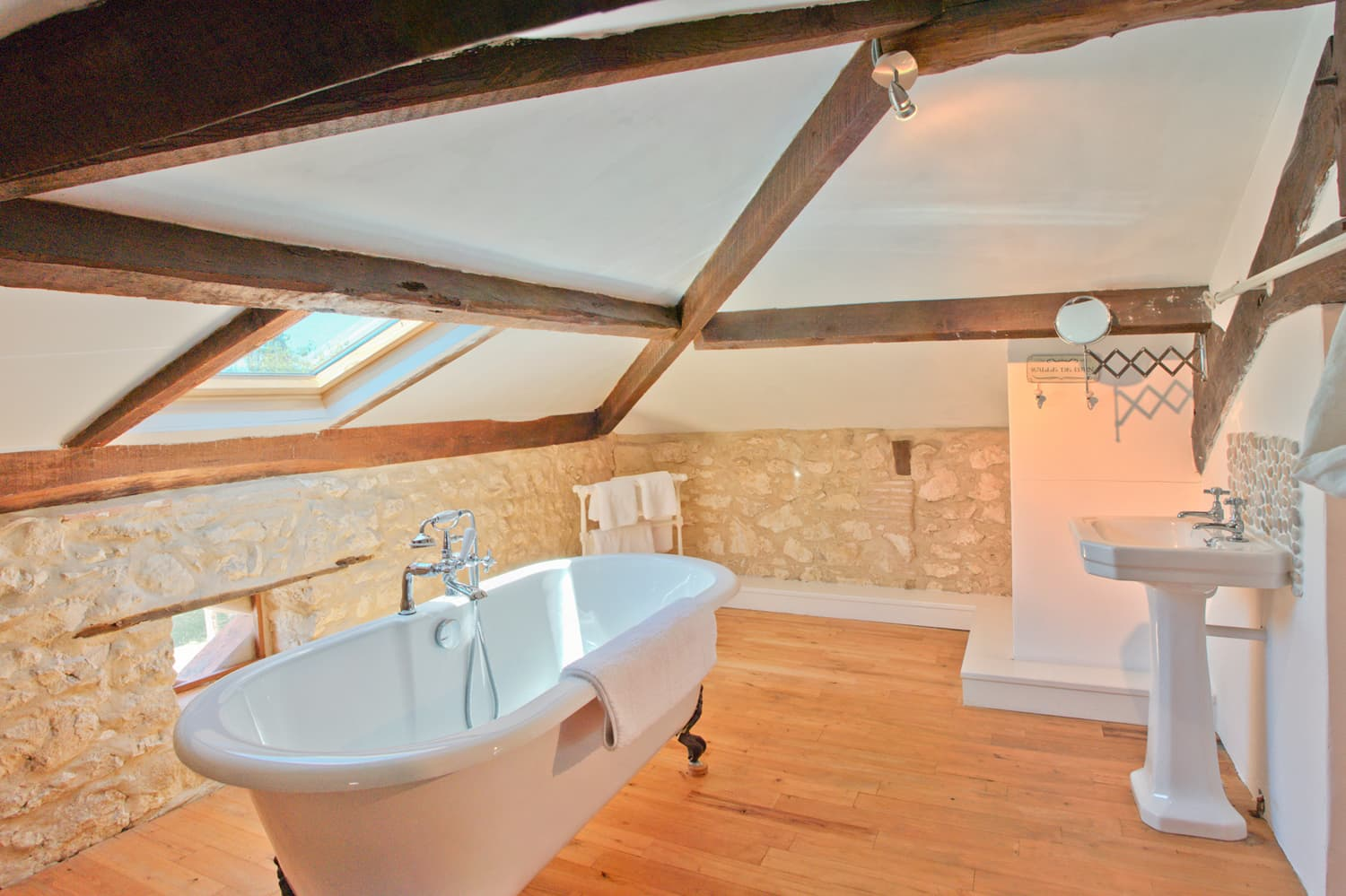 Bathroom with roll-top bath in South West France holiday accommodation