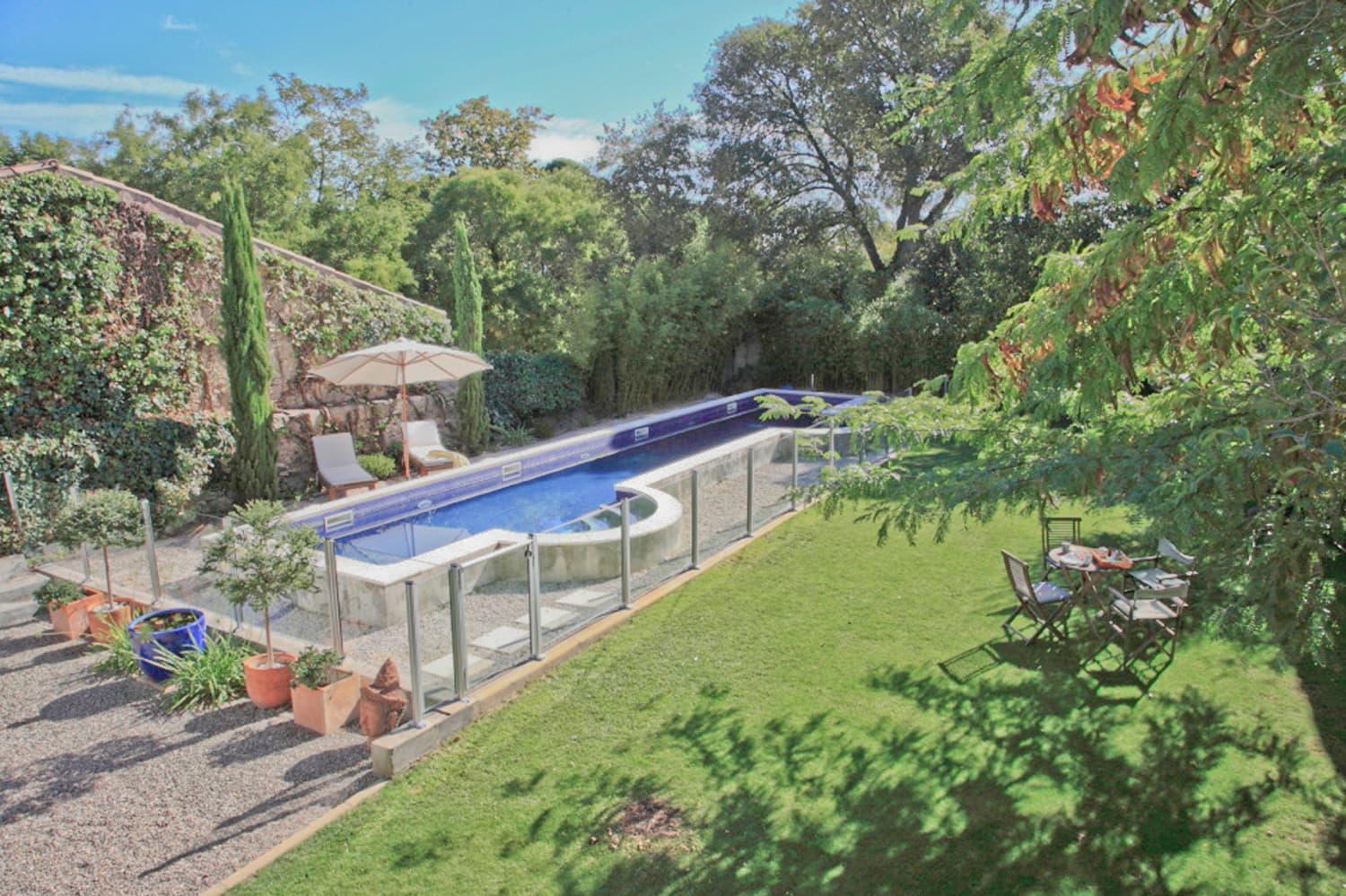 Private pool with lawned garden