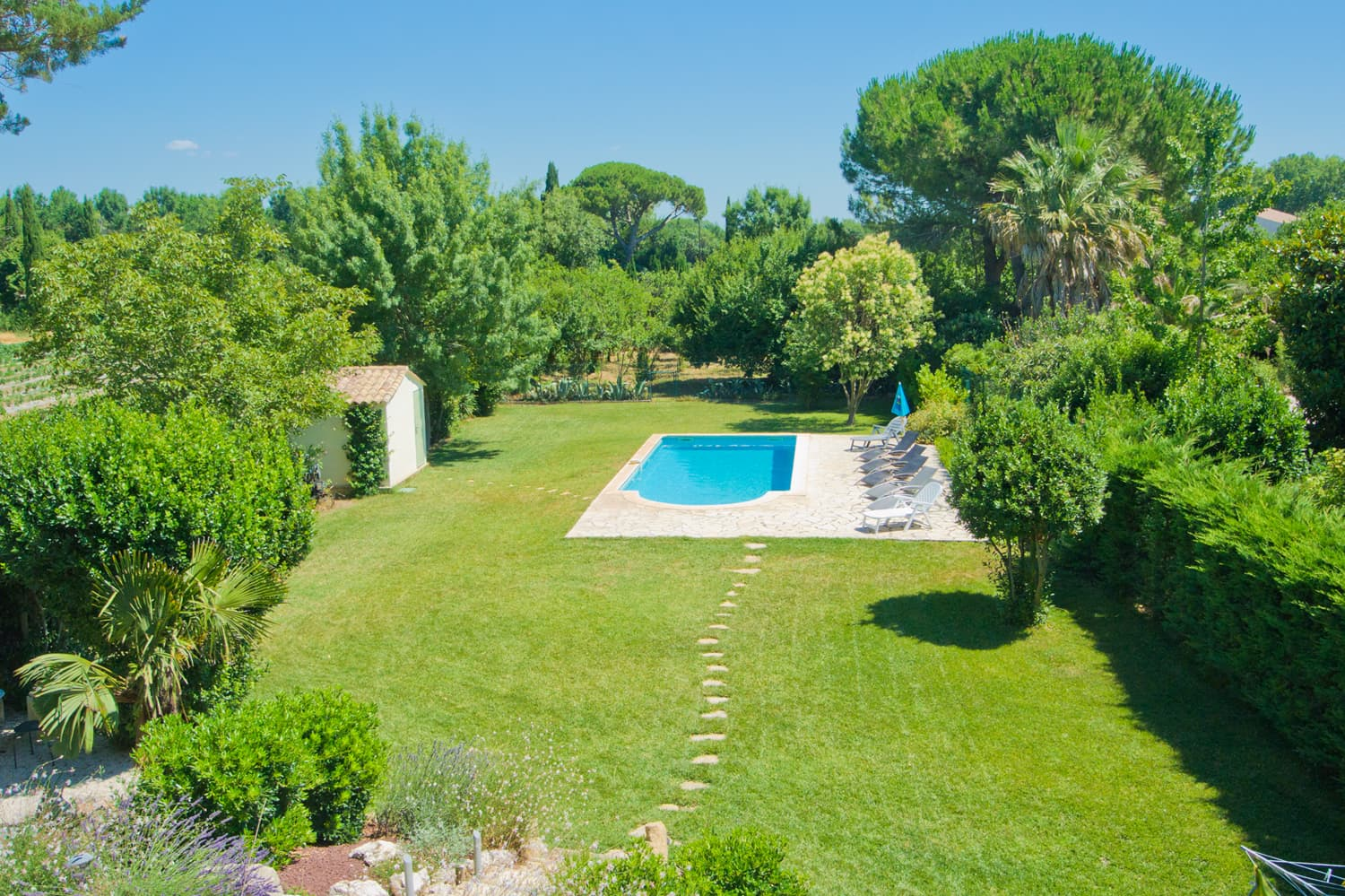 Lawned garden with private pool