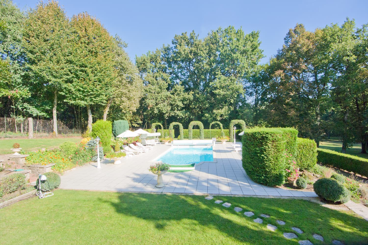 Private, heated pool with garden