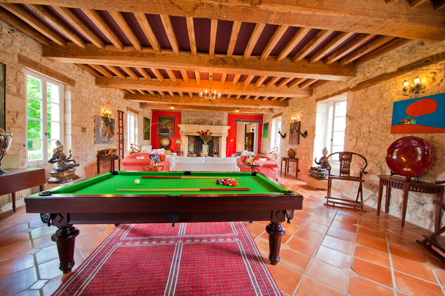 Living room with snooker table in Dordogne holiday château