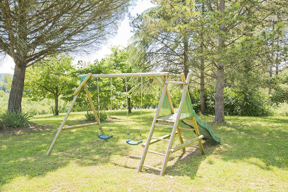 Lawned garden with swings