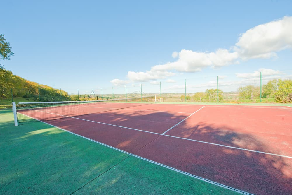 Private tennis court in château grounds